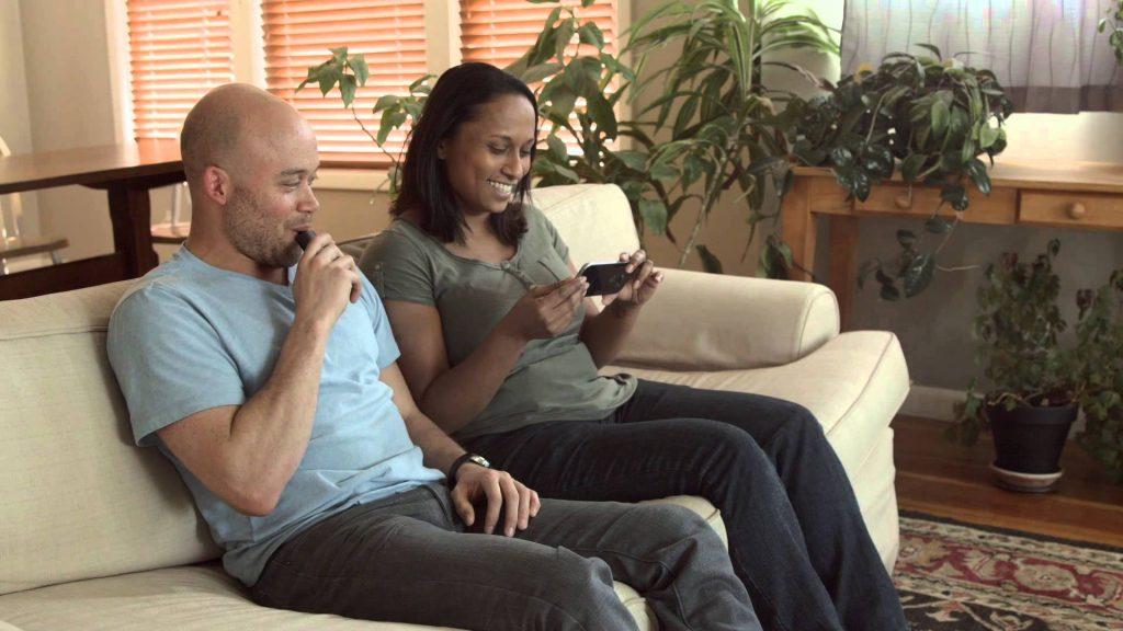 Man and woman vaping marijuana